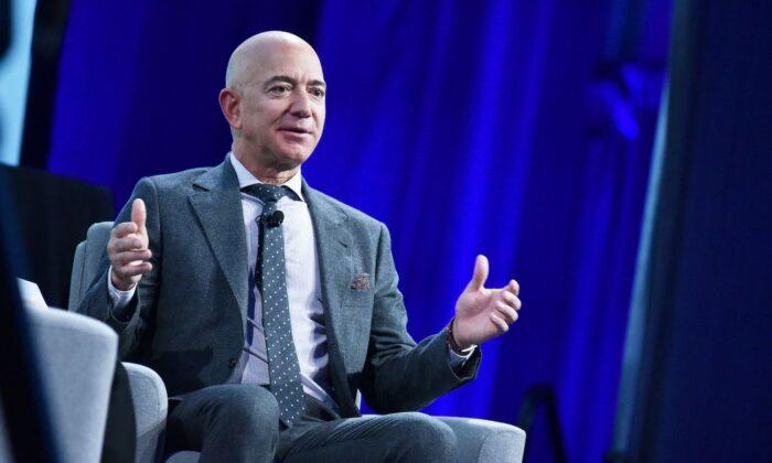 Bezos to Give Amazon Reins to Cloud Boss Jassy as Sales Rocket Past $100 Billion